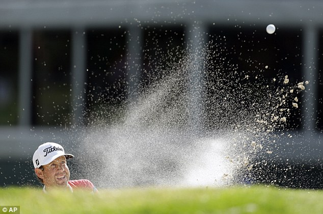 In the sand: Erik Compton, who has had two heart transplants, finished tied for fifth