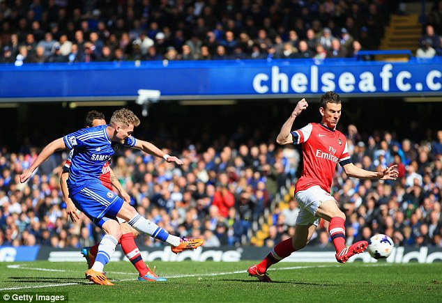 German engineering: Andre Schurrle fires past Laurent Koscielny as Chelsea staked their claim for the title