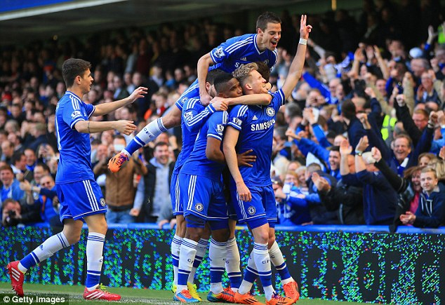 Frontrunners: Chelsea celebrate going seven points clear of Arsenal after a 6-0 thrashing at Stamford Bridge
