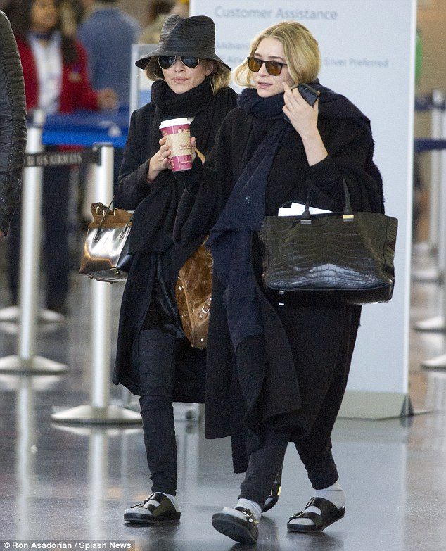 Twin look: While the twins dress the same they also appeared to be sharing the same cup of takeaway coffee