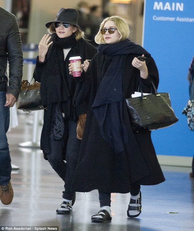 Letting their feet breath: While the Olsen twins wrapped their bodies up warmly they let their feet breath in socks and sandals