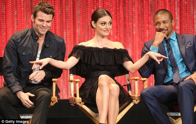 She's animated: Phoebe was the centre of attention flanked by Daniel Gillies and Charles Michael Davis