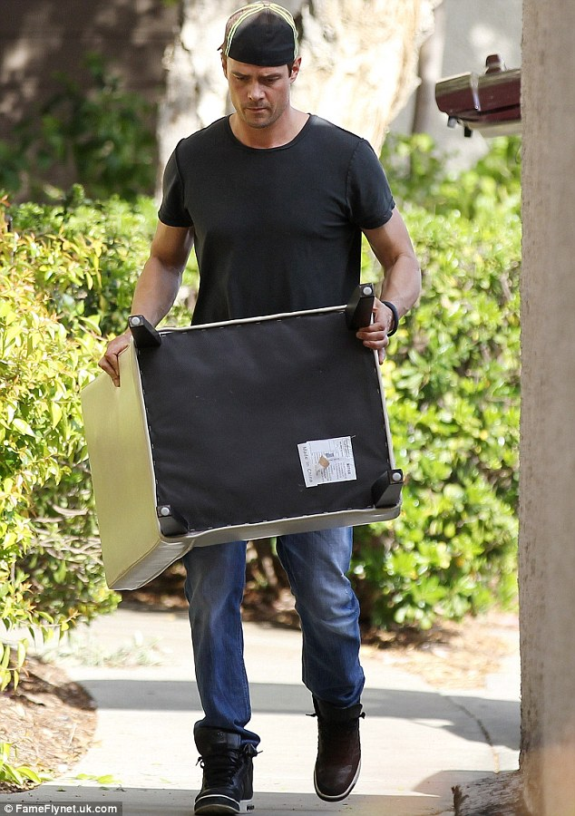 Where you taking that? The husband of Black Eyed Peas singer Fergie showed no signs of where the furniture was going