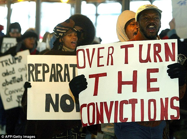 The men's convictions were overturned in 2002