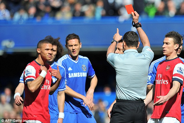 Gaffe: Referee Andre Marriner says he is devastated at the sending off of Kieran Gibbs on Saturday lunchtime