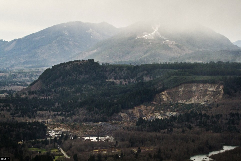 Forever changed: The extensive damage of the landslide after taking out a chunk of earth from the side of the hill facing the Stillaguamish River