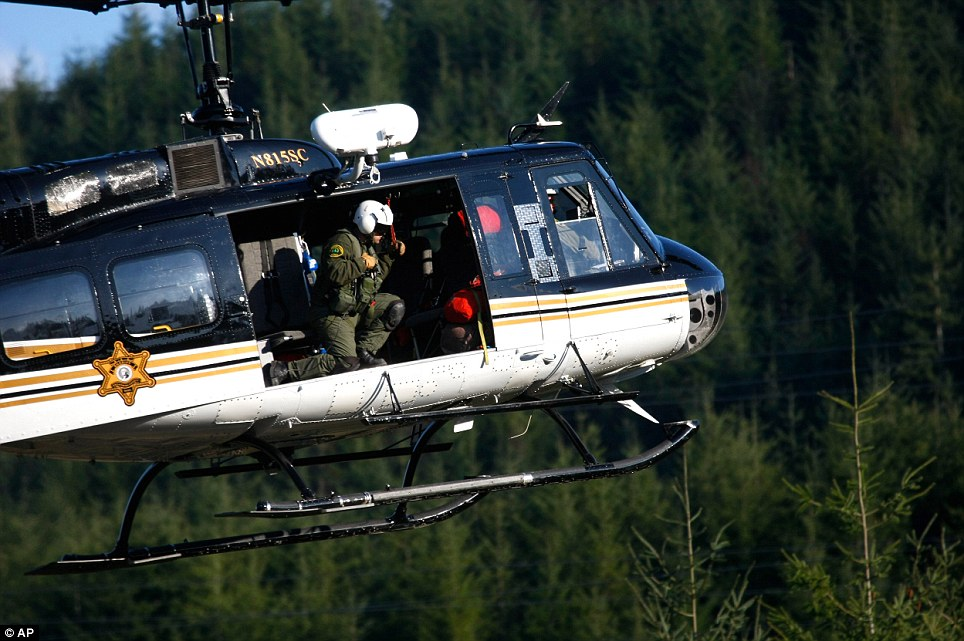 Here to help: This search helicopter looks for bodies - alive or dead - among the ruins of the catastrophic mudflow