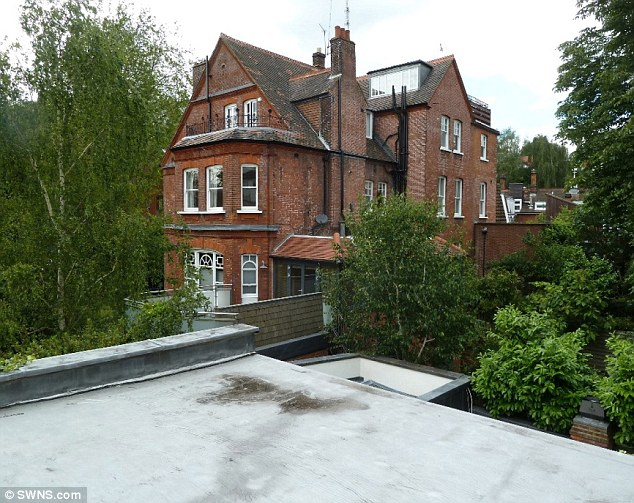 As it stands: A view from the flat roof looking south towards existing access from dormer windows