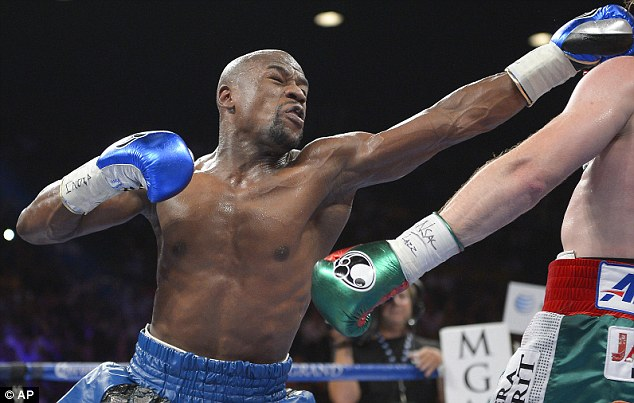 Out of reach: Khan had hoped to fight Floyd Mayweather Jr but he will now be part of the American's undercard