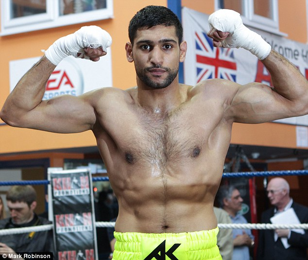 Comeback: Amir Khan will return to the ring after announcing he is to appear on the undercard of Floyd Mayweather Jnr's next title fight in Las Vegas
