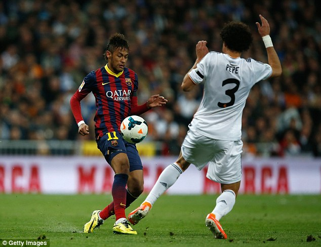 Day job: Neymar takes on Real Madrid defender Pepe in Barcelona's 4-3 win on Sunday night