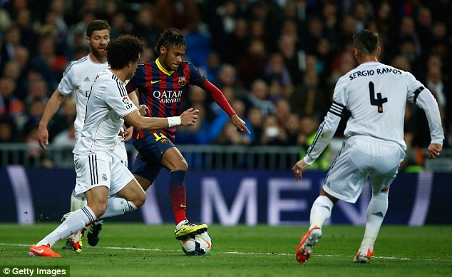 On the run: Neymar takes on Pepe and Sergio Ramos during the first half at the Bernabeu