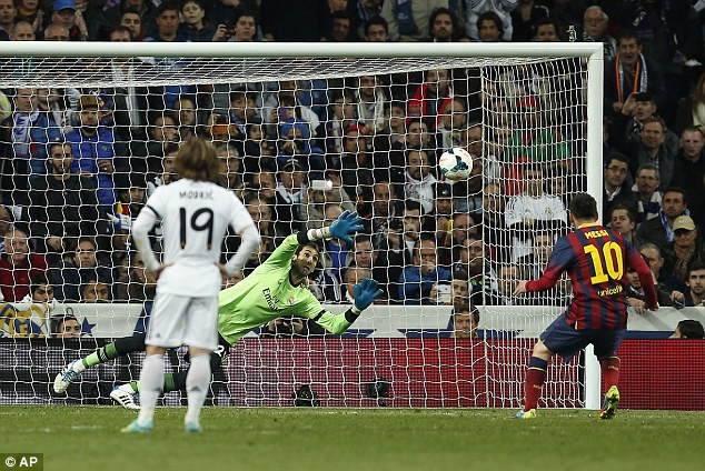 On the spot: Messi scores his second penalty and third goal of the night to seal a 4-3 win