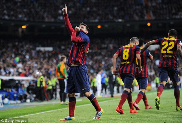 Sealed with a kiss: Messi shows some affection to the Barcelona badge after netting the winning goal