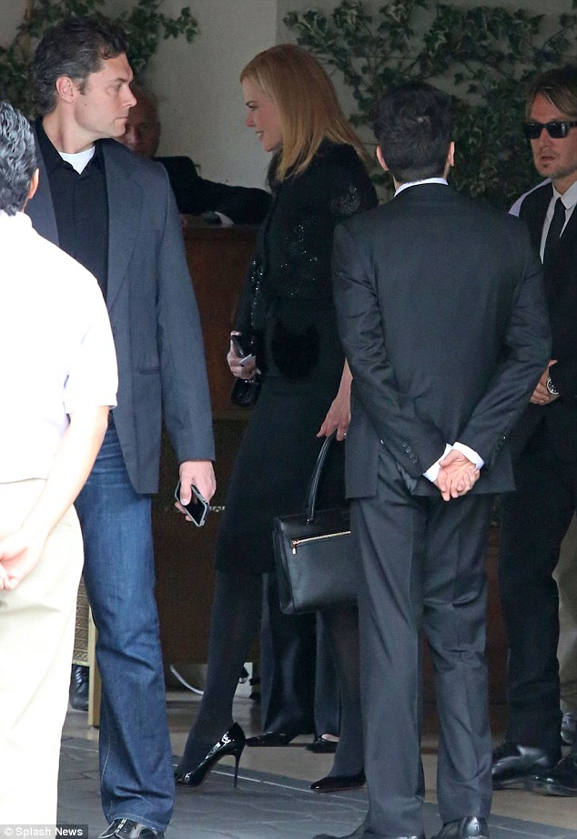 Mourners: Nicole Kidman, who was a close friend of L'Wren Scott for 25 years, and her husband Keith Urban leave a reception following the designer's funeral in Hollywood, Ca. on Tuesday afternoon