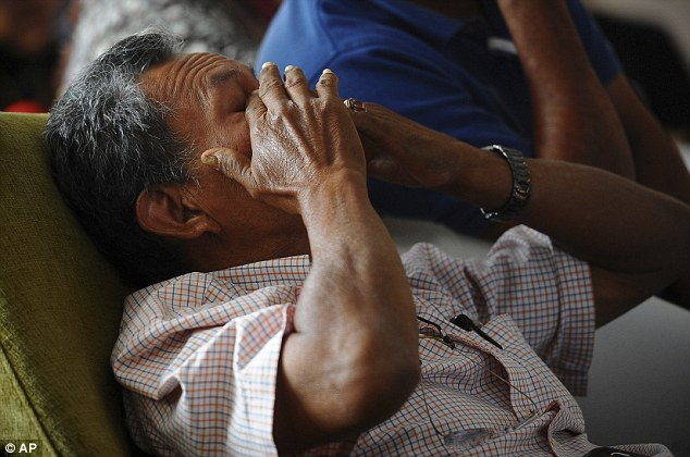 Heartache: Selamat Omar, 60, whose son Khairul Amri was on a missing Malaysia Airlines plane, reacts while watching a live broadcast of a press conference by Malaysian acting Transport Minister Hishammuddin Hussein on Tuesday