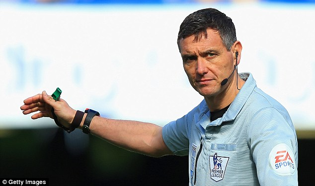Back to work: The referee's governing body have decided to keep Marriner refereeing again straight away