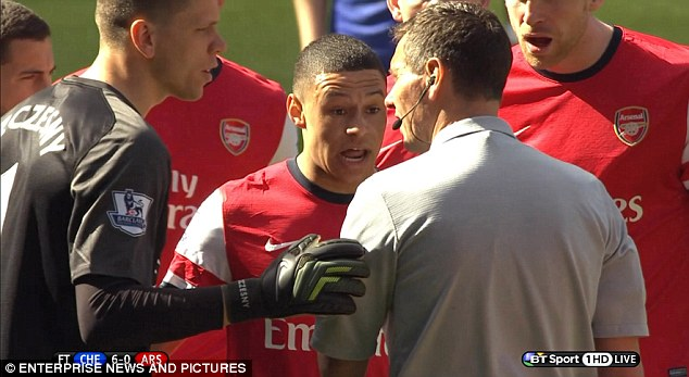 Injustice: Oxlade-Chamberlain tries to explain to Marriner that it was actually him that handled the ball, not Gibbs