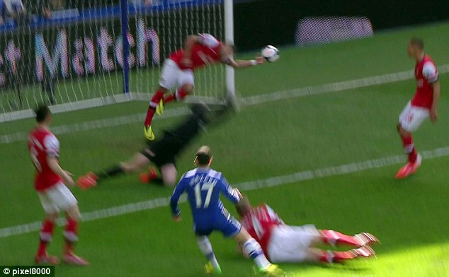 Off target: Eden Hazard's shot was actually handled by Alex Oxlade-Chamberlain and was going wide