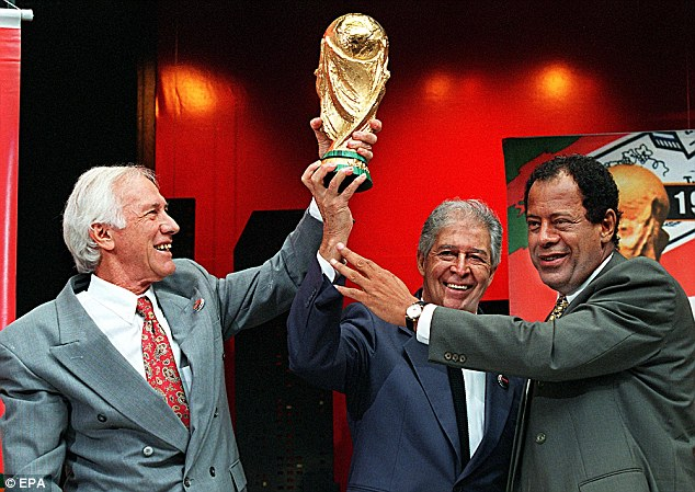 Legacy: Hilderaldo Bellini (left) was the first Brazilian captain to lift the World Cup for his country, in 1958