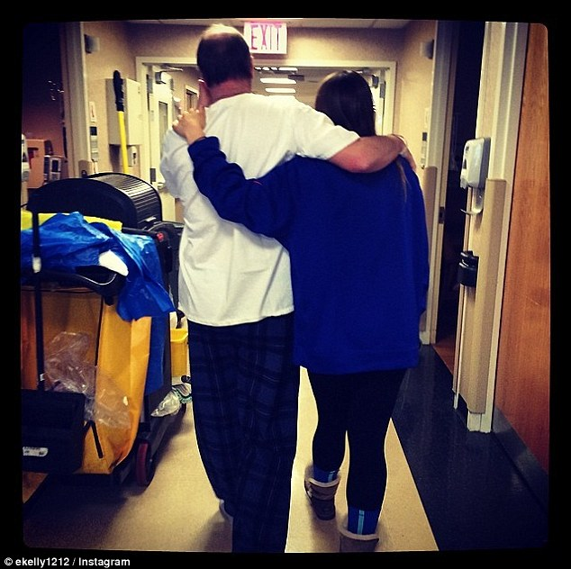 Heartbreaking: In another picture, Kelly is seen walking in a hospital ward. 'So thankful that he was up for a little walk today!!! God is good!!!! And He HEALS!!!!' Erin wrote