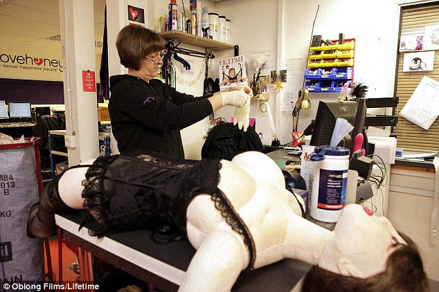 Tough job: Andrea prepares to inspect Jessica, the deluxe 'teddybabe' returned to her department