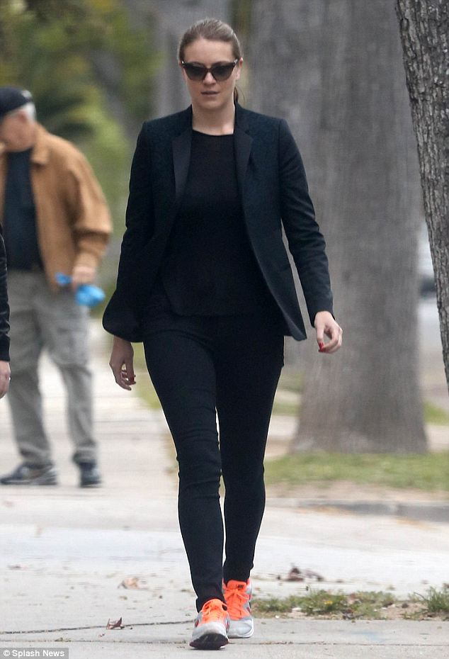 All black: Brittany Penebre, Scott's assistant seen in LA today, was the one to find the designer's body