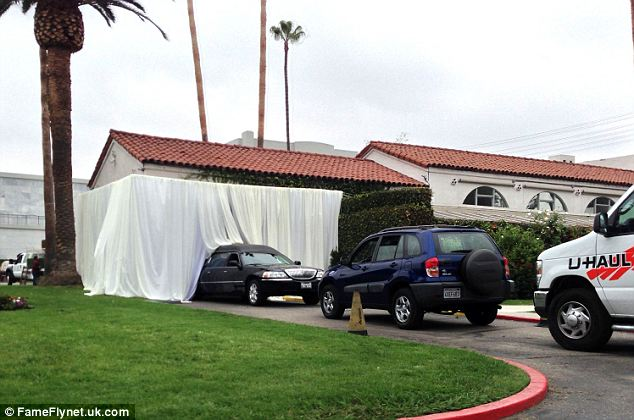 Covered arrivals: The Hollywood Forever Cemetery arranged to have curtains blocking the view of the guests' arrivals on Tuesday ahead of the funeral
