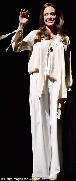 Amazing grace: The mother-of-six caught attention and held it from the moment she walked on stage in a form-flattering ivory ensemble