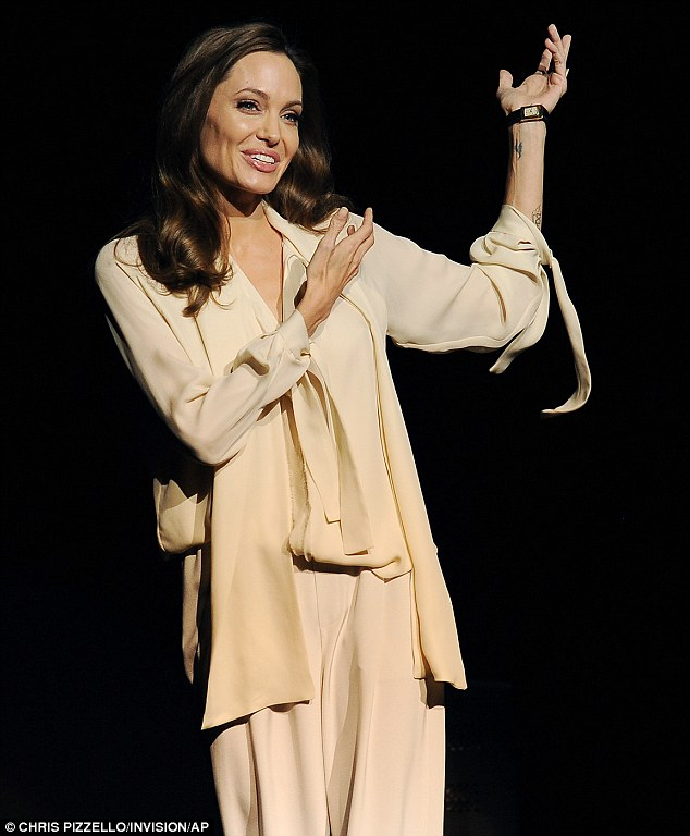 Captivating: Angelina held her audience captive as she described Unbroken as 'the journey of man finding his way through the darkness and into the light'