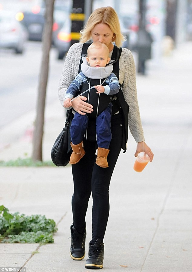 Smooches! Malin Akerman planted a kiss on her son Sebastian's head on Tuesday as she carried him around on a West Hollywood stroll