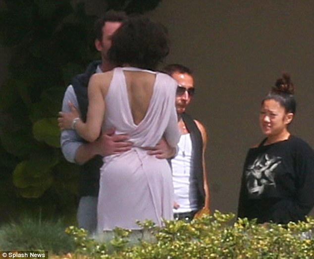 Are you seeing this, Robin? Paula's publicist Jeff Raymond snuck his hands around her waist at the shoot