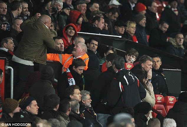 Making a point: The fan ranted at Moyes as other supporters in the south stand watched on