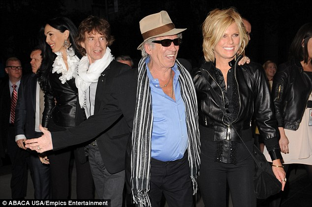 Big family: L'Wren Scott pictured with Mick Jagger, Keith Richards and his wife Patti Hansen
