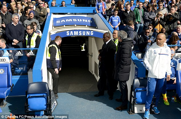 Early exit: Mourinho left his seat at the sidelines early to inform his wife of Chelsea's 6-0 drubbing of Arsenal
