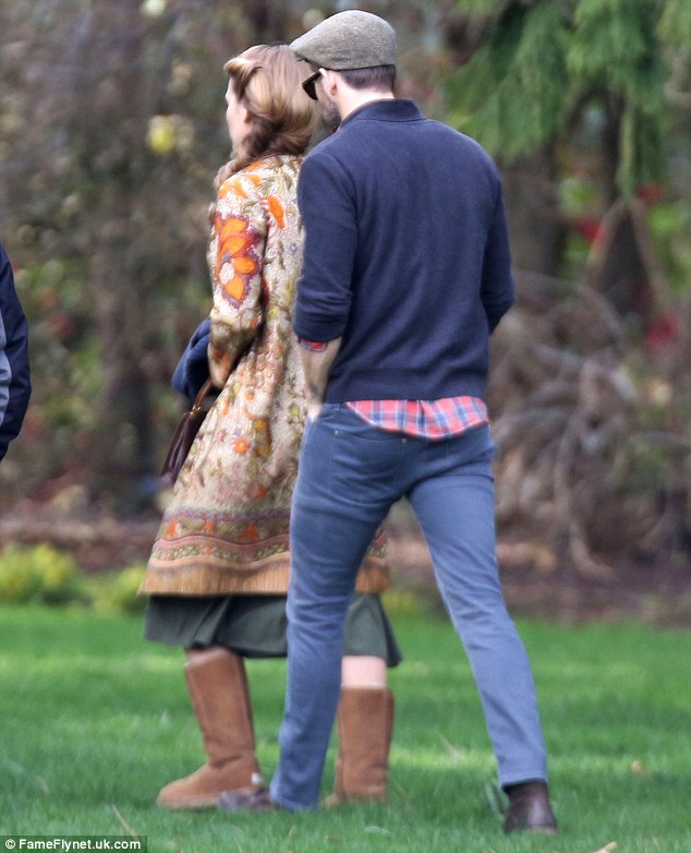 The good-looking duo: The Proposal actor trailed closely behind his younger wife while on the set of The Age of Adaline
