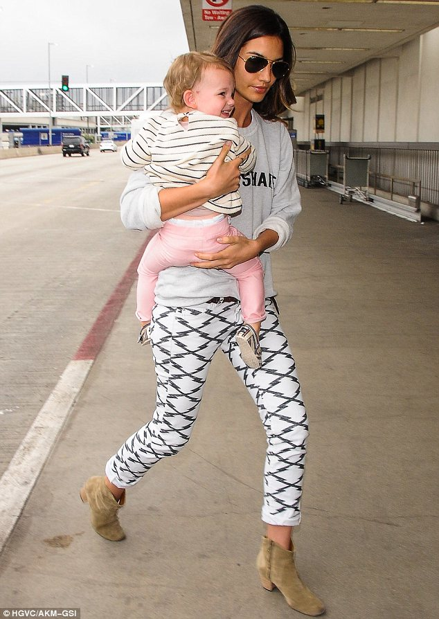 Precious cargo: Lily Aldridge carried her giggling daughter Dixie and wore an Aha Shake sweater as she made her way through LAX on Tuesday