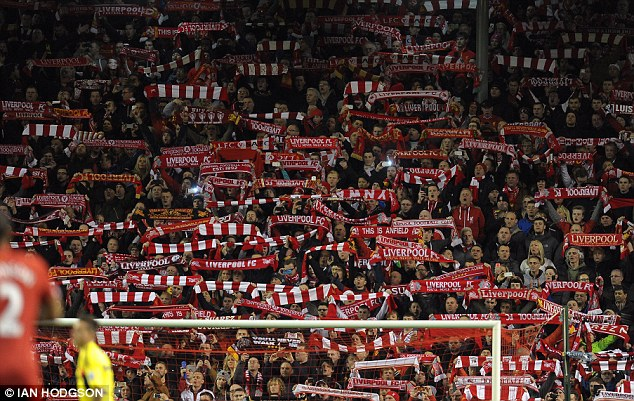 Fervent support: The Kop are watching a genuine title charge - and they are loving every minute