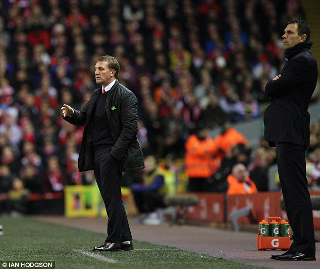 Contrasting views: Brendan Rodgers is chasing the title, but Gus Poyet is staring relegation in the face
