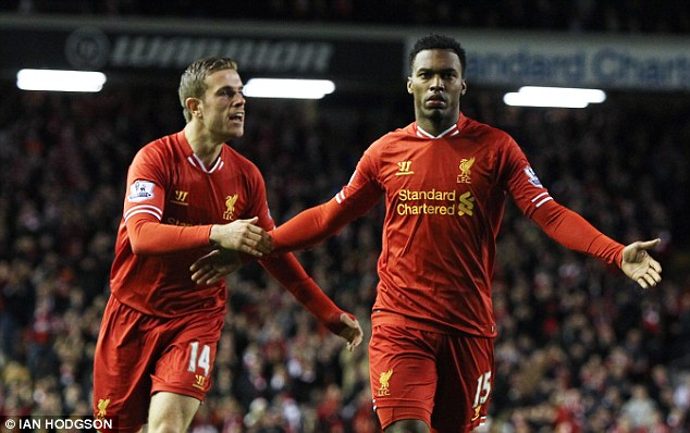 Dan the man: Sturridge (right) hit what proved to be an invaluable strike - his 20th of the season