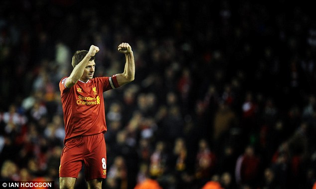 Making a good fist of it: Steven Gerrard gestures to the Kop at full time with Liverpool trailing leaders Chelsea by a solitary point