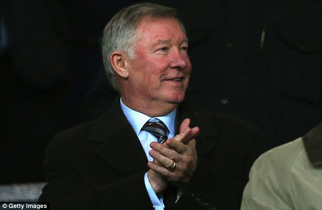 Watching over: Ferguson applauds before his former team are convincingly beaten by rivals City