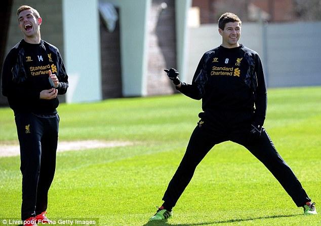 All smiles: Jordan Henderson and Steven Gerrard share a joke in training ahead of their match against Sunderland