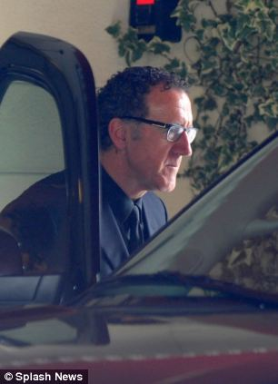 L'Wren Scott's older brother Randall Bambrough arrives at the funeral