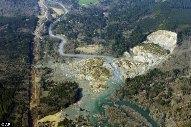 Devastation: An aerial photo taken on Monday shows the mountainside to days after the slide