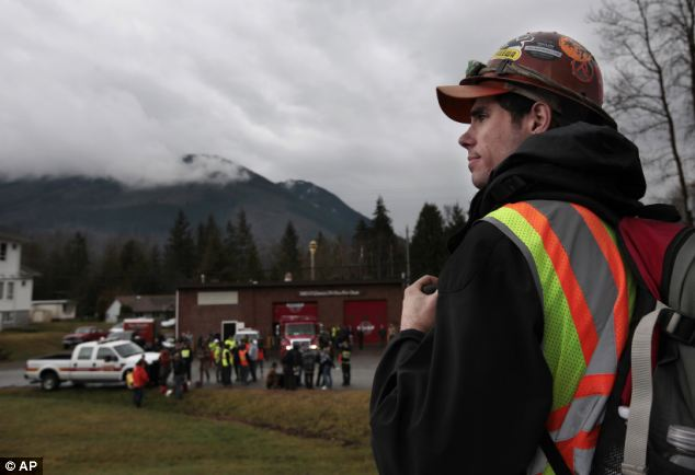 Helping hand: Derek Stephani, an electrician, drove up to volunteer to find slide victims in Oso