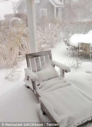 Not spring yet: The late-season storm covered Nantucket with snow and forced residents to 'hole up'