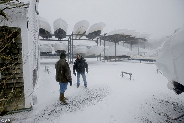 Securing the ships: Marina employees in Chatham check on the boats that they had been tasked with caring for over the winter as the storm was expected to carry through Wednesday