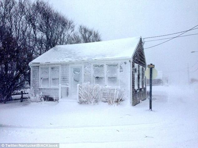 Far cry from it's name: Windows on Beach Street in the Nantucket town of Sconset are completely covered with snow as winds in the area climbed above 80 miles per hour