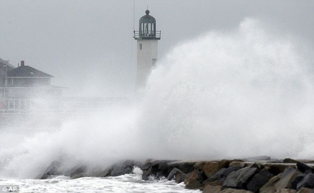 Rude awakening: Wind-driven waves crash on a sea wall in Scituate, Massachusetts on Wednesday morning